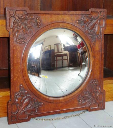 Arthur Simpson/Baillie Scott carved mirror