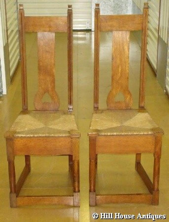 Pair of Wylie & Lochhead Arts & Crafts hall chairs