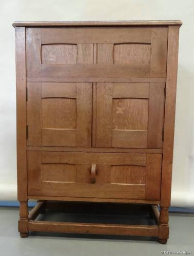 Unusual Cotswold School oak cabinet desk