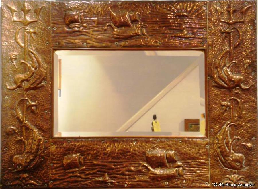 Large Newlyn School copper mirror