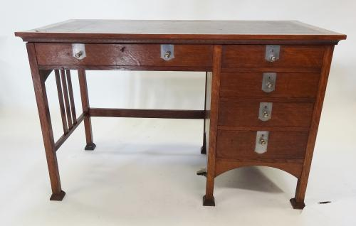 JS Henry GM Ellwood oak Voyseyesque desk