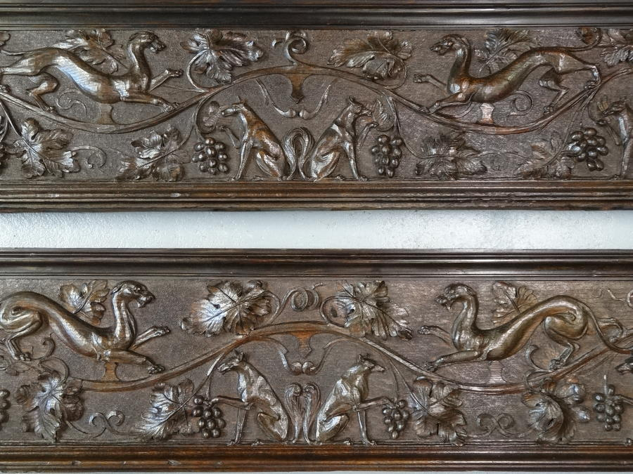 Pair of richly carved animal dog panels
