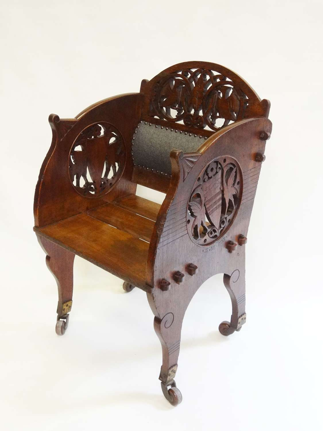 Rare Art Furniture carved oak armchair by Walford & Donkin