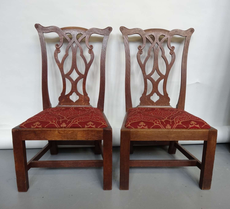 Pair of Sir Robert Lorimer oak gossip chairs