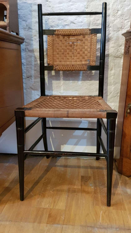 Rare EW Godwin ebonised wicker side chair