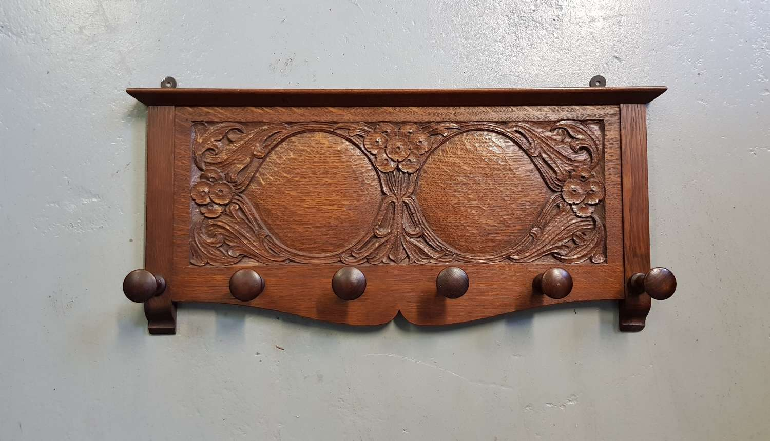 Arthur Simpson of Kendal Arts & Crafts carved pegged coat rack