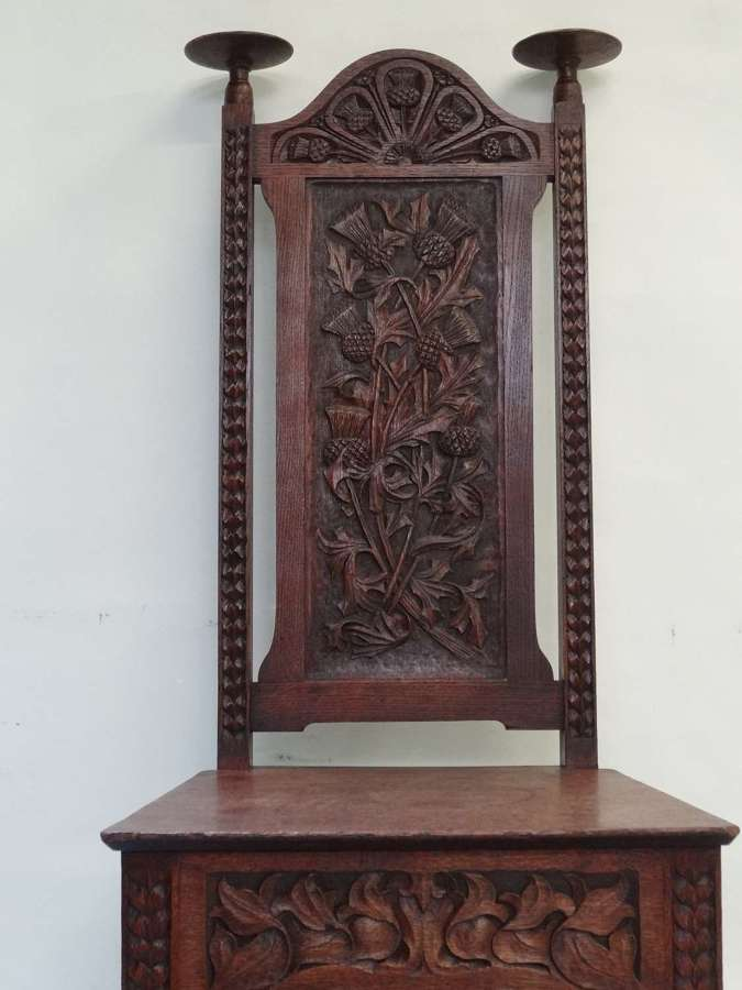 Arts and Crafts carved oak chair Wickham Jarvis