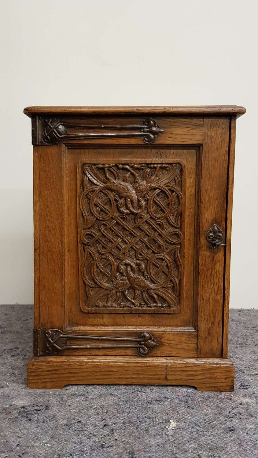 Arts & Crafts carved oak Home Industries small cabinet Baillie Scott
