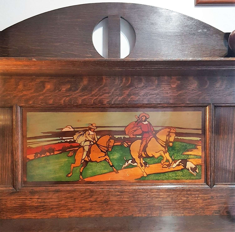 Shapland & Petter Arts & Crafts oak stencilled panel bookcase